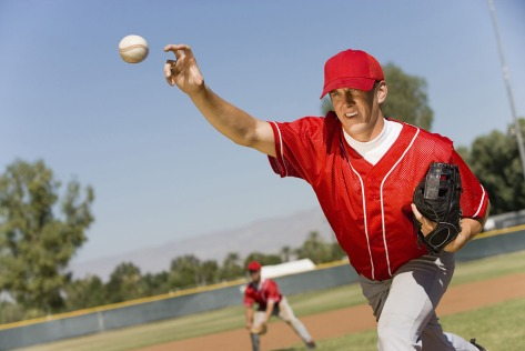 older-baseball-pitcher-throwing